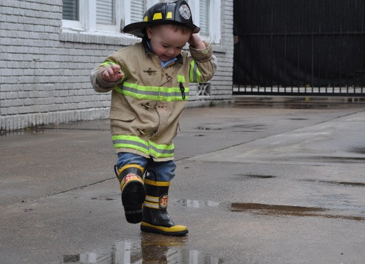 Baby Spashing in Rain Puddles