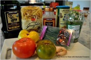 Ingredients for pasta and marinated tomatoes
