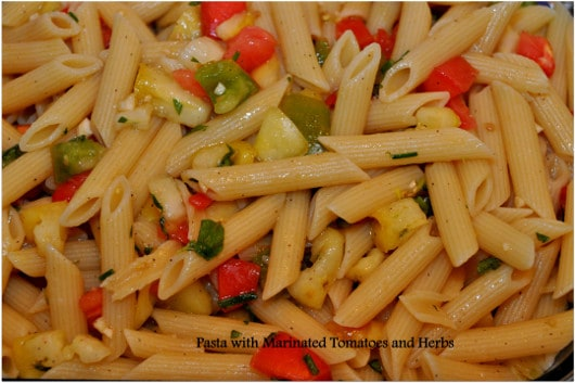 Pasta with marinated tomatoes and herbs