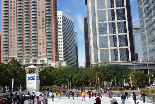 Ice at Discovery Green 2013 with Downtown Houston Buildings
