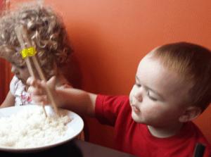James Eating Rice at Mama Fus