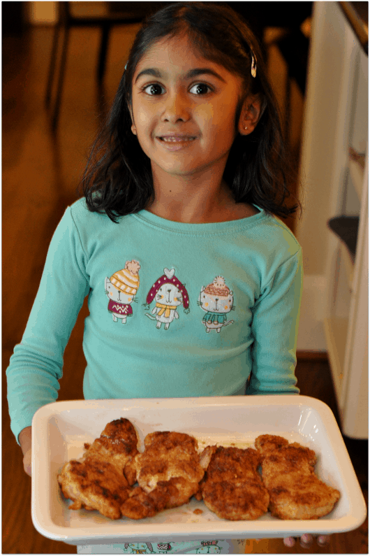 Pretty Girl Helping with Fried Chicken Dinner