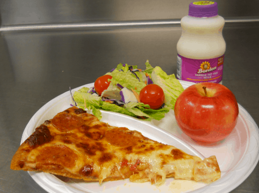 A student favorite – pizza – is now made at schools with whole-grain crust and low-fat cheese, and served with a garden salad, piece of fruit and fat-free milk.