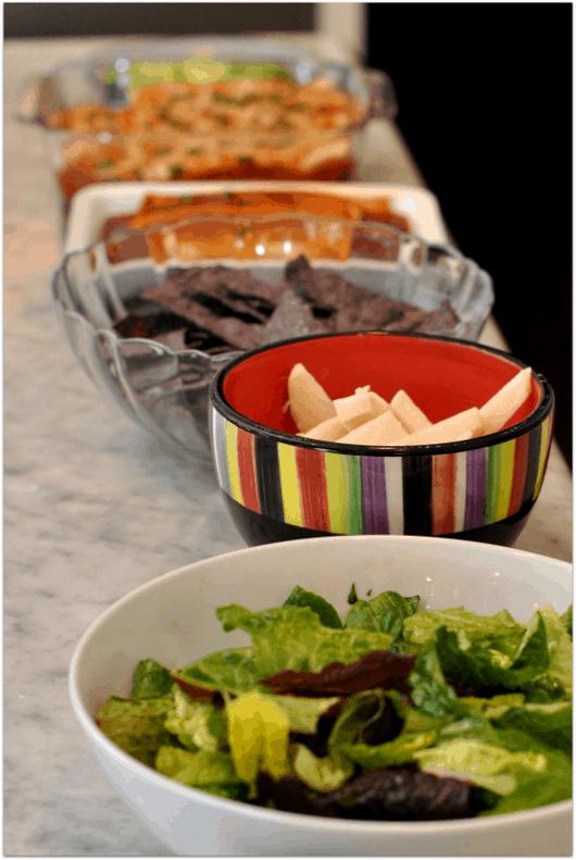 Lettuce, chips, enchiladas