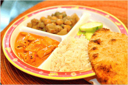 Indian Kids Meal with rice naan potatoes and tikka masala