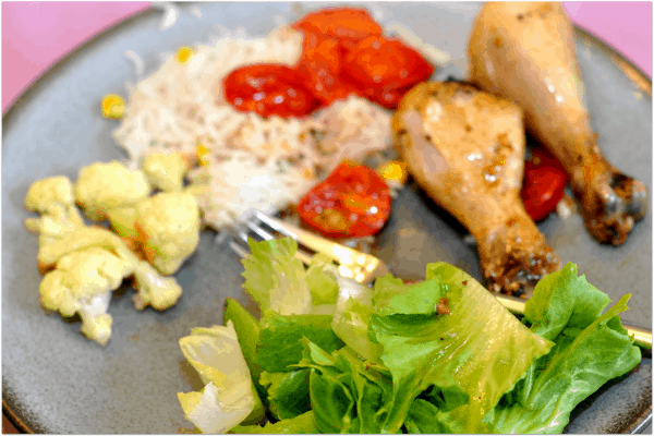 Roasted Chicken with Tomatoes and roasted cauliflower sald and rice