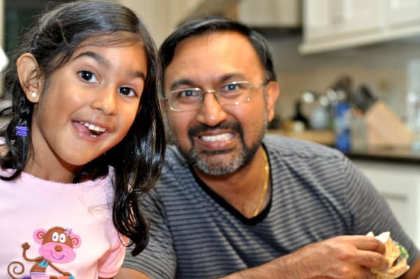 Dad and Daughter Enjoying Dinner