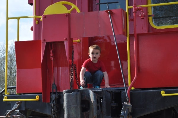 Playing on Caboose at Tomball Train Depot
