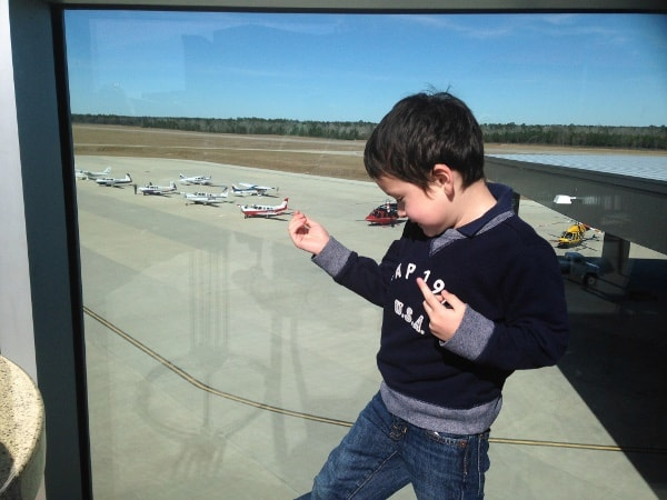 Looking at Airplanes at Black Walnut at Conroe Airport