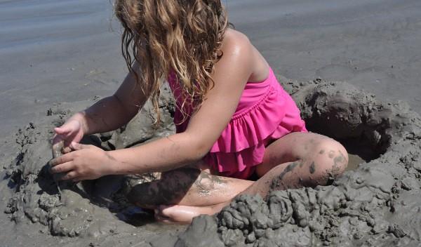 East Beach Galveston Digging in Sand
