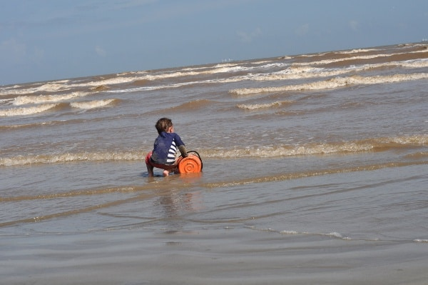 East Beach Galveston Playing in Water