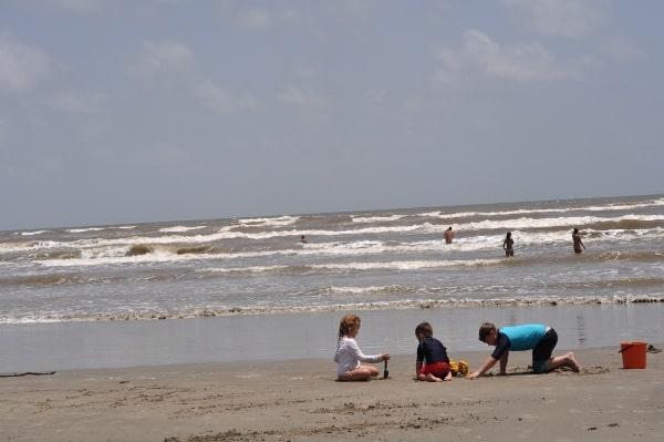 Galveston West Beach Digging in Sand