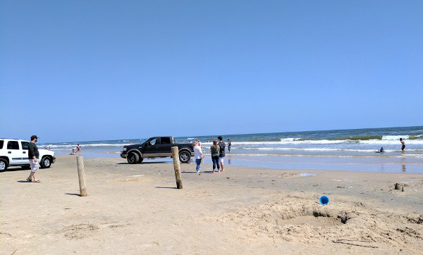 Second On The Car Side Of Beach Vehicles Were Avoiding Soft Sand And Driving Wet Which Is Where People Playing In Water