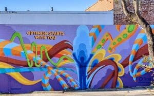 Optimism Begins with you mural in East End Houston