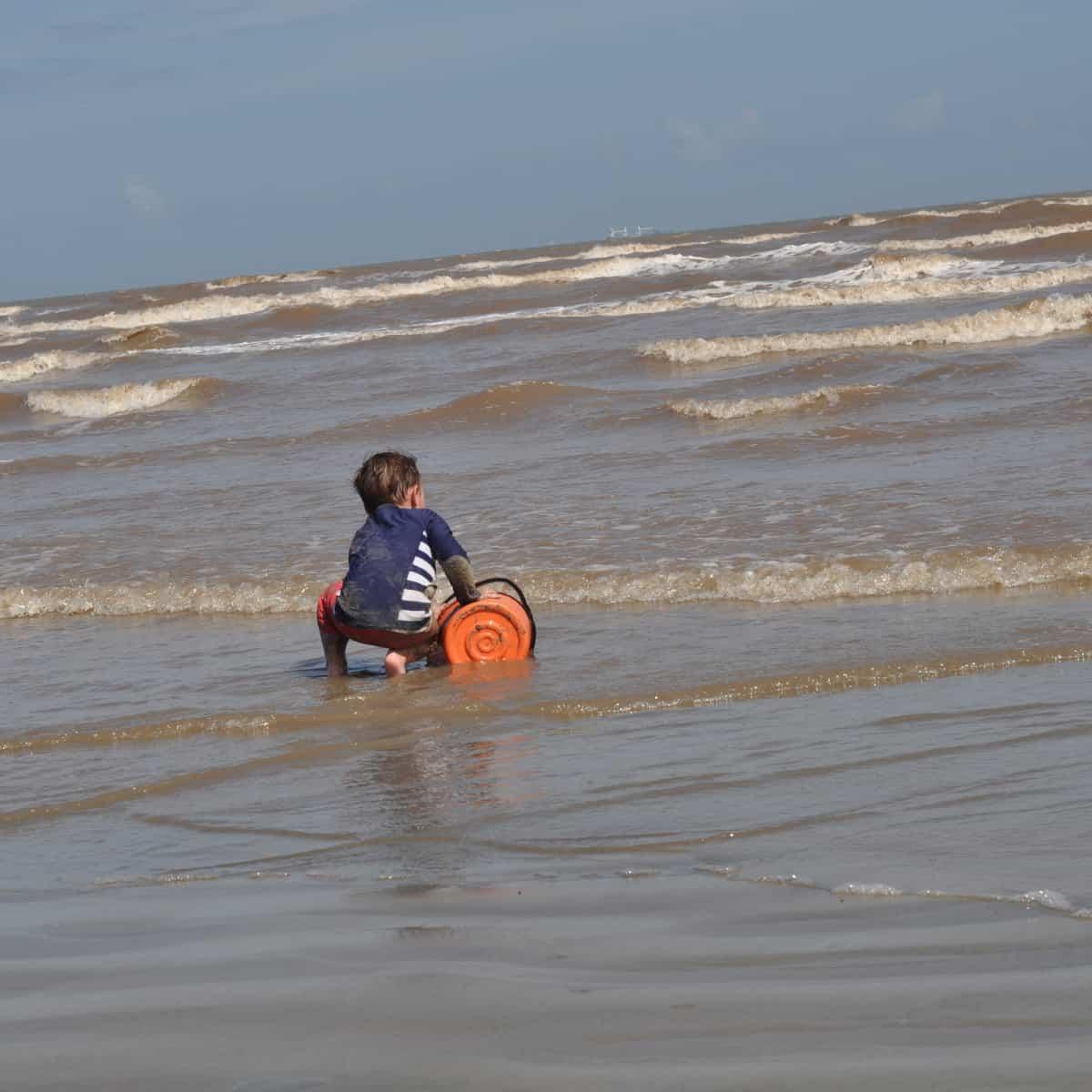 East Beach Galveston Island Playing in Water