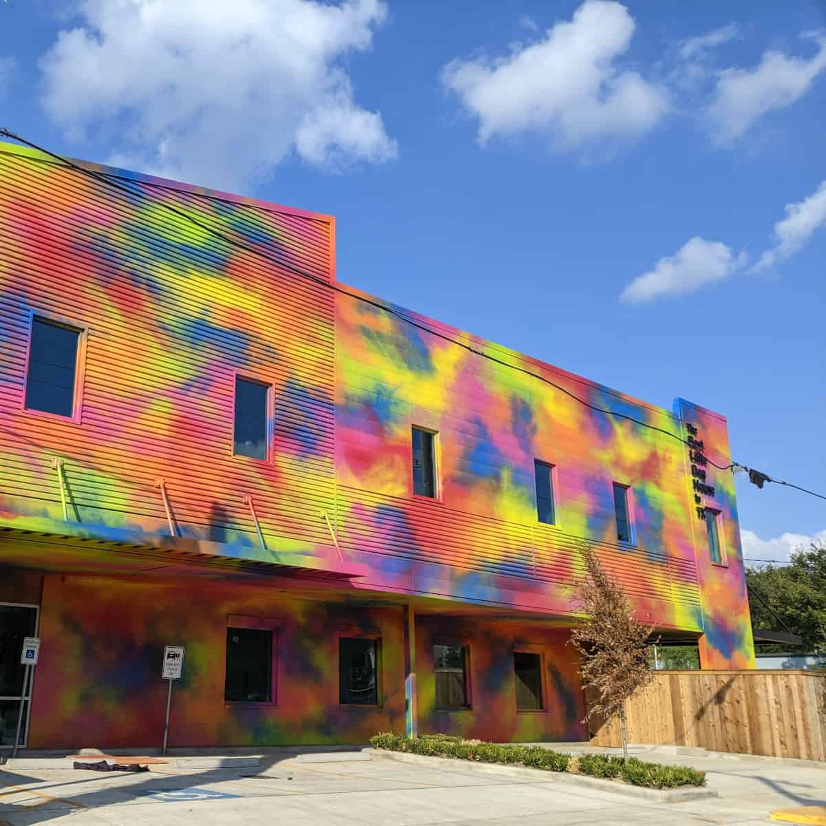 Best Little Dog House in Texas Tie Dyed Painted Building