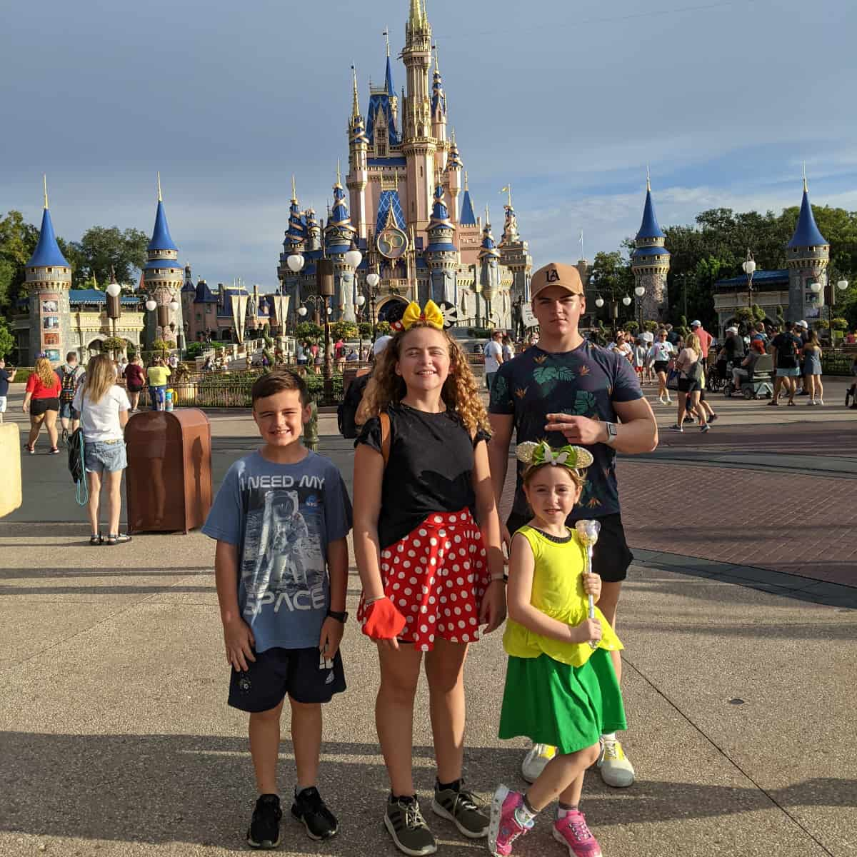 Kids in front of Castle at Magic Kingdom