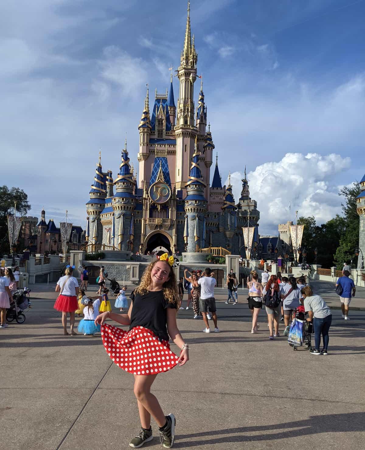 Magic Kingdom Castle and Teen in Minnie Dress